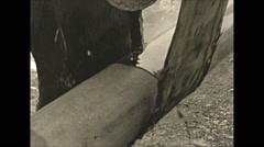 Vintage 16mm film, pipe tarring sealing, close up, wartime Alaska 1943 Stock Footage