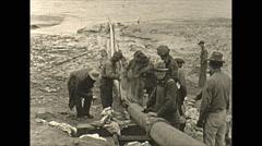 Vintage 16mm film, pipe tarring sealing tilt up, wartime Alaska 1943 Stock Footage