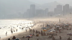 Backlot. Tourists enjoying the famous Ipanema beach, Rio de Janeiro, Brazil Stock Footage