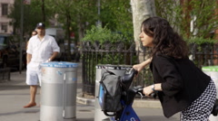 Citibike woman lady skirt citi bike street peddling bicycle slow motion 4K NYC Stock Footage