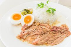 Stewed pork leg and egg on rice Stock Photos