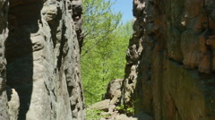 3562 Split Rock Cliff Blue Sky Forest, HD Stock Footage
