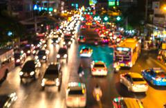 Abstact blur bokeh of Evening traffic jam on road in city. Stock Photos