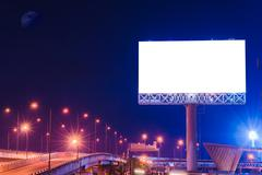 Blank billboard at twilight time for advertisement. Stock Photos