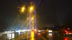 Driving on the Bosphorus Bridge on a rainy night Stock Footage