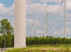 Eco power in wind turbine farm Kuvituskuvat