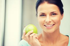 lovely housewife with green apple - stock photo