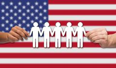 hands holding people pictogram over american flag - stock photo