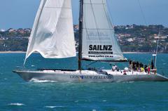 SailNZ's maxi yacht Lion New Zealand leaving Auckland's Waitemata Harbour Stock Photos