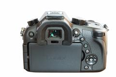Panasonic Lumix DMC- FZ1000 bridge digital camera isolated on white backgroun - stock photo