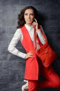 Business Woman in Smart Office Outfit with Matching Handbag - stock photo