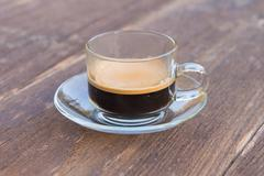 cup of espresso on woodentable background - stock photo