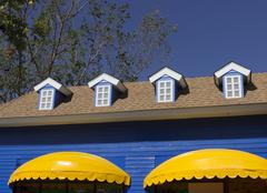 yellow awning and blue window shop - stock photo