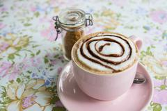 hot mocha topping with foamy milk and chocolate sauce in pink cup - stock photo