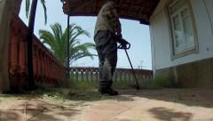 Trimmer Cleaning Patio Floor Stock Footage