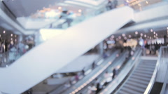 Blurred off focus background of people moving on escalators in shopping mall Stock Footage