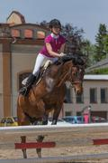 Young horsewoman in action. Vertically. - stock photo