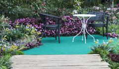 Stock Photo of table and chair in hedge of garden
