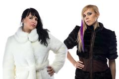 Photo of two women in fake fur coats Stock Photos