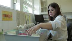 Doctor researching microbiological specimens in bacteriological laboratory. - stock footage