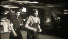 2081 - people walk a Chicago street market in the 1940's-vintage film home movie - stock footage