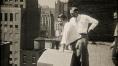 2079 - businessmen on rooftop overlook Chicago skyline - vintage film home movie Stock Footage