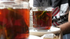 Drinking an arabic tea with mint Stock Footage
