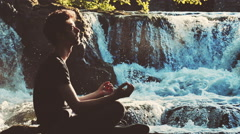 Young boy in meditation in nature yoga, concentration, martial arts Stock Footage