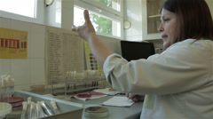 Bacteriological laboratory, doctor analyzes biological samples of patients. Stock Footage