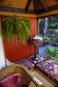 Hanging plant and red Tiffany lamp - stock photo