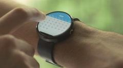 Stock Video Footage of 4K Smartwatch Calendar Planning Swiping