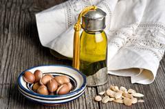 Argan oil and fruit Stock Photos