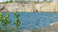 Lake in the granite quarry with rocky shores 003 HD Footage
