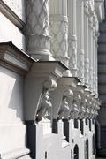 Colonnade on a building with decoration head lion Stock Photos