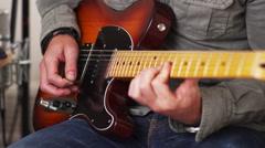 Man strumming electric guitar - stock footage