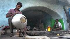 Traditional blacksmith workshop in Hyderabad, India Stock Footage