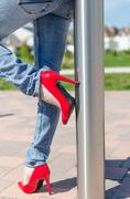 Fashioned woman wearing red high heel shoes - stock photo