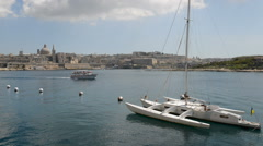 The view on Valletta and sail yacht with Ukrainian flag Stock Footage
