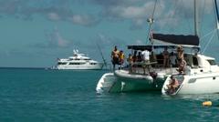Barbados St. James 052 catamaran and motor yacht at anchor in Paynes Bay Stock Footage