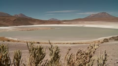 Lagoon Hedionda in Andes of Bolivia with falmingos Stock Footage