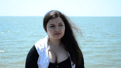 The girl against the sea Stock Footage