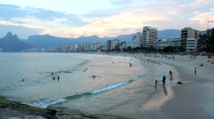 Backlot. Tourists enjoying the beach at Brazil, Ipanema Beach, Rio de Janeiro. - stock footage
