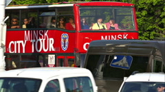 "Red Bus With Caption ""Minsk City Tour"" Rides on Street Stock Footage"