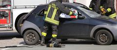 Firefighters freed the wounded by car accident sheet - stock photo