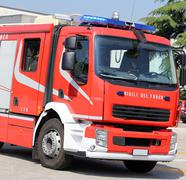 Large fire trucks quickly runs during an emergency Kuvituskuvat