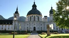 Breeze stirs leaves morning light Ettal Abbey Bavaria Germany-HD P 0450 Stock Footage