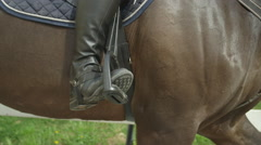 SLOW MOTION CLOSE UP: Dressage rider in the saddle Stock Footage