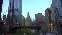 Stock Video Footage of Civic district of Chicago Riverwalk near Wabash Avenue Bridge.