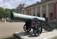 Bronze canon outside Discover Greenwich, Royal Naval College London England - stock photo