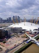 Aerial view of London Docklands and O2 arena from an Emirates Sky Train gondo - stock photo